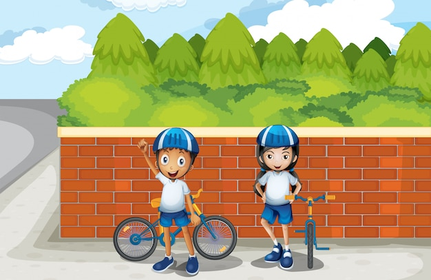 Two young bikers at the street