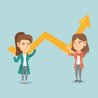 Two young business women holding growth graph.