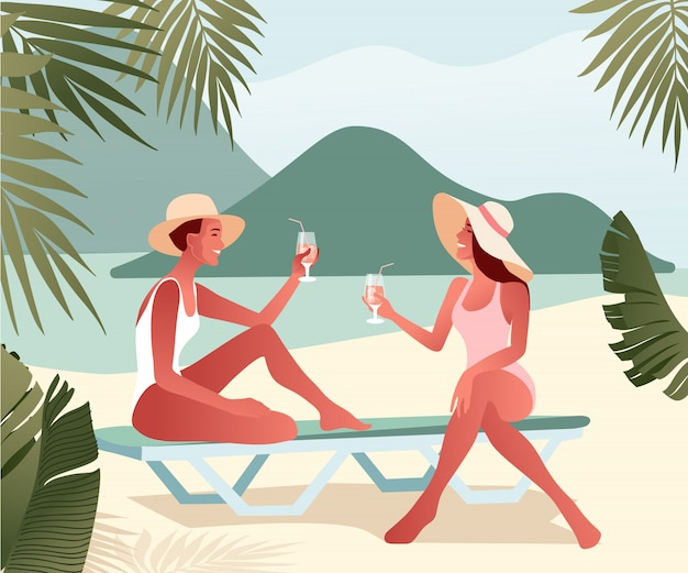 Two young girls in summer hats chatting on beach and drinking cocktails. female characters near the sea.