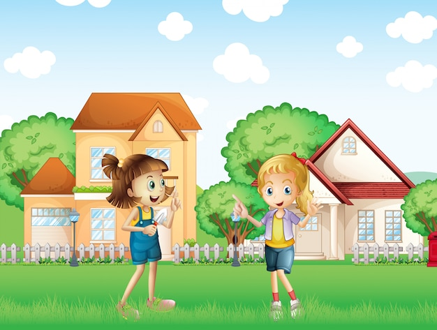 Two young ladies playing in the ground in front of the houses