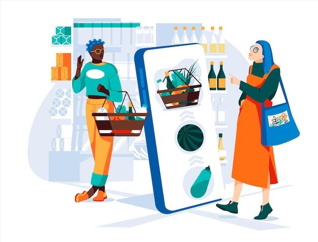2人の若い女性がスマートフォンのショーウィンドウの大画面を使用して食料品店で選択を行います