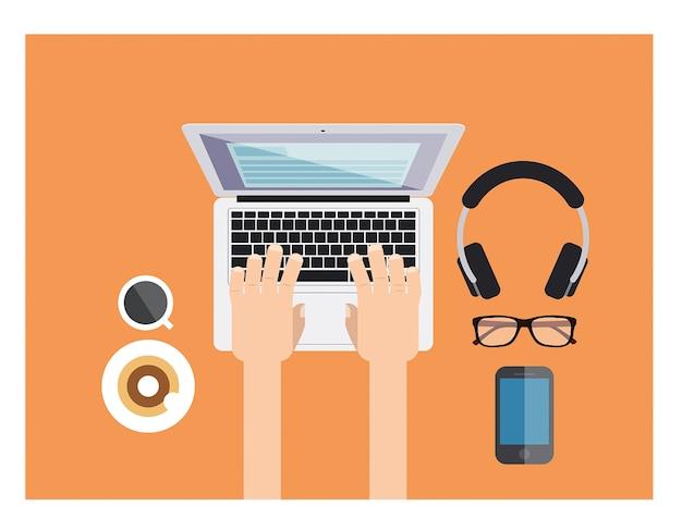 Typing on laptop keyboard while drinking coffee
