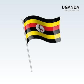Uganda waving flag isolated on gray background