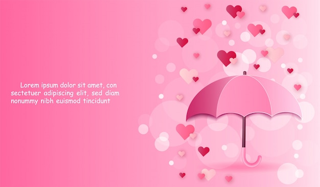 Зонтик и сердце на розовом фоне.