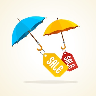 Umbrellas with sale stickers, tags and labels. winter, autumn, summer.