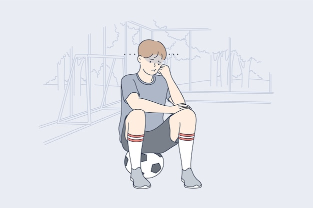 Undepressed frustrated child soccer player sitting on ball