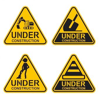 Под строительство знак установлен. предупреждение значок коллекции, изолированных на белом фоне.
