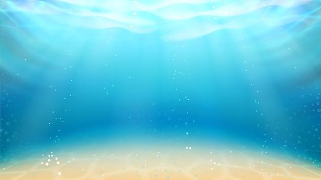 Underwater ocean sandy bottom and sunrays