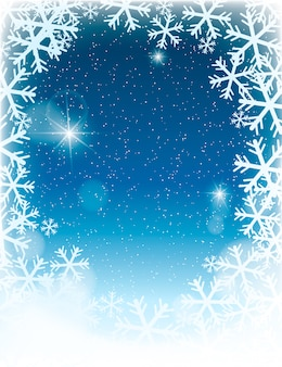 Unfocused winter landscape background with snowflakes