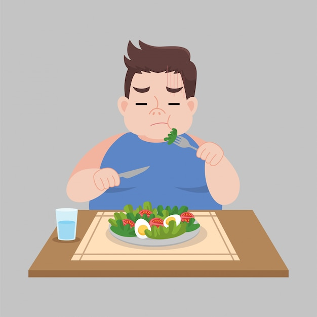 Unhappy fat man not want to eat vegetable salad foods