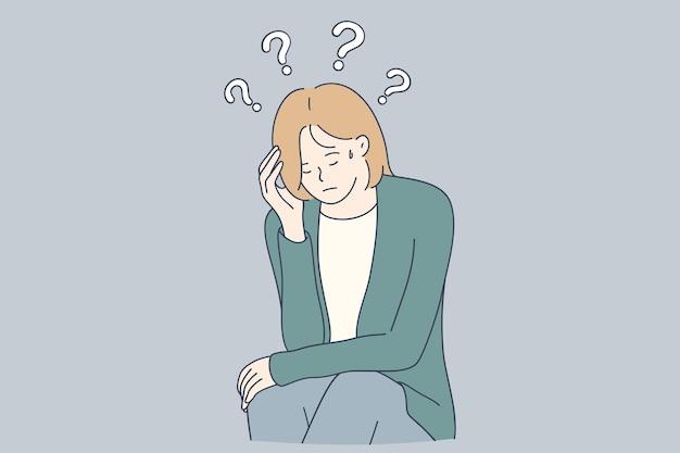 Несчастная женщина сидит, касаясь головы и чувствуя себя подавленной мыслями