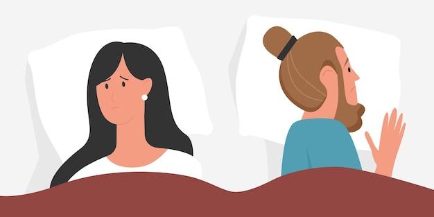 ベッドの関係の問題で不幸な若いカップルの人々が一緒に横たわっている悲しい男女性
