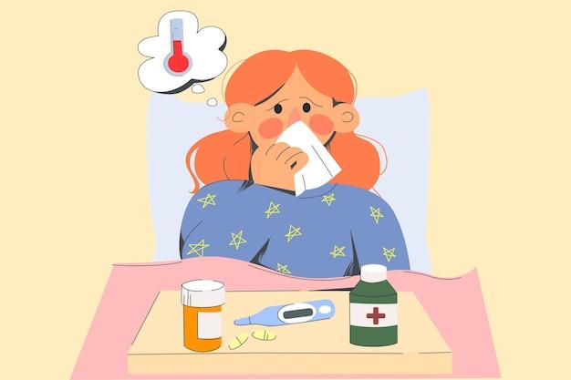 不健康な女性がベッドにとどまる熱に苦しむ