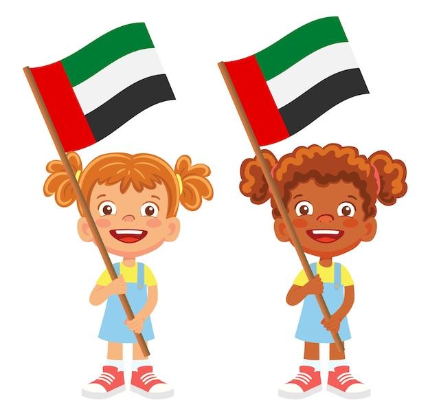 Флаг объединенных арабских эмиратов в руке. дети держат флаг. национальный флаг объединенных арабских векторов