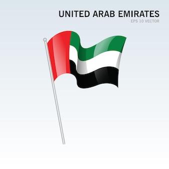 Развевающийся флаг объединенных арабских эмиратов, изолированные на серый