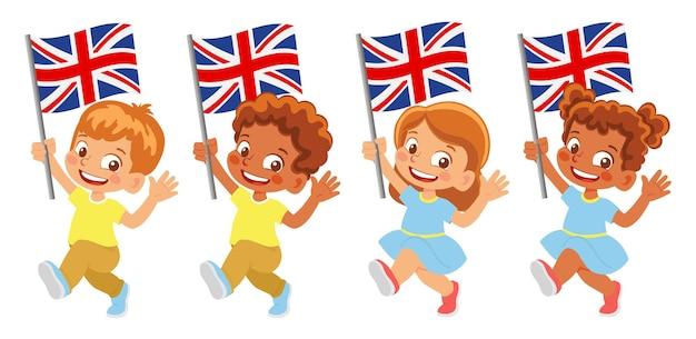 United kingdom flag in hand. children holding flag. national flag of united kingdom