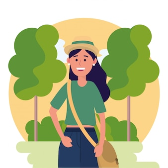 University woman wearing hat and trees with bushes