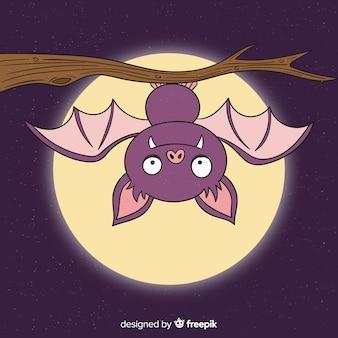 Upside down bat hanging on a branch