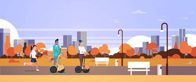 Urban autumn park outdoors activities man woman riding gyroscooter running nature city buildings street lamps cityscape horizontal banner flat