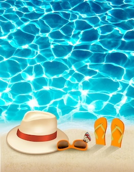 Vacation background with blue sea, a hat and sunglasses.