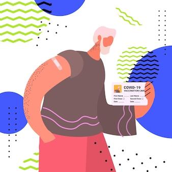 ワクチン接種記録カード免疫パスポートリスクフリーcovid-19パンデミックpcr証明書コロナウイルス概念肖像画ベクトルイラストを保持しているワクチン接種された男