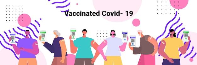 Vaccinated people using digital immunity passport on smartphone screens risk free covid-19 pandemic