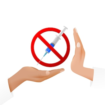 Vaccination or drugs refusal concept. a syringe on the hand in a prohibitory sign and a hand expressing protest.