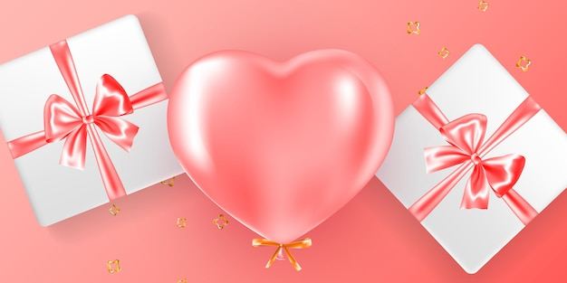Valentine composition with pink helium balloon and gift boxes