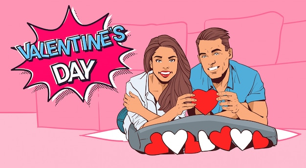 Valentine dat retro design happy couple hold red heart lying on bed comic style