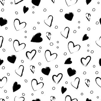 バレンタインデーのお祭りの装飾ハートサークルとシームレスなスタイリッシュなトレンディな黒と白のパターン...