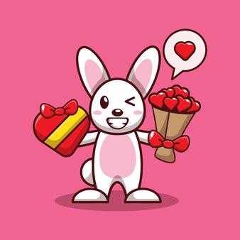 Валентина дизайн милый кролик держит подарок на день святого валентина и букет цветов любви