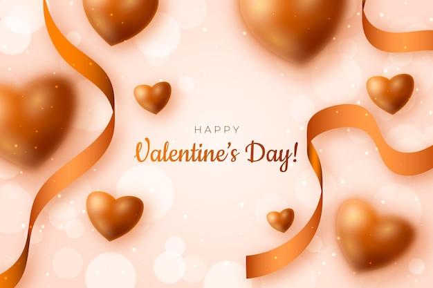 金色のぼやけた要素とバレンタインデーの背景
