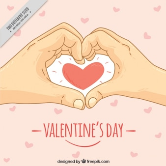 Sfondo di san valentino con disegnati a mano le mani e il cuore