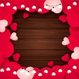 Valentine's day background with paper hearts, heart shaped bulbs and rustic wood, romantic red background