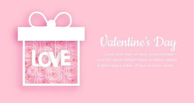 バレンタインバナーと紙のバラのボックスと背景カットスタイル