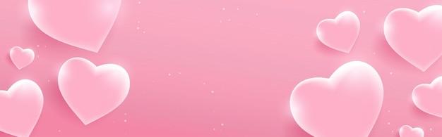 光沢のあるピンクのハートとバレンタインデーのバナー