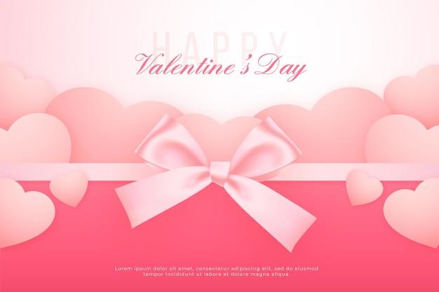リボンと紙のハート、素敵なピンクの背景とバレンタインデーのバナー