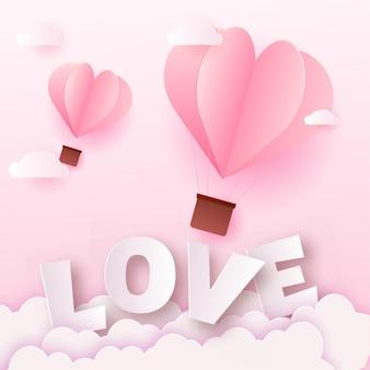 ピンクの紙の愛のテキストと気球のバレンタインデーカード