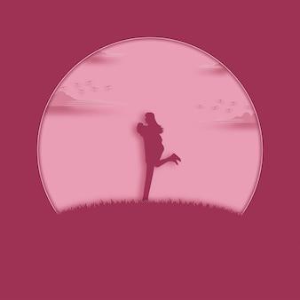バレンタインデーのコンセプト。愛に満足しているカップルはピンクの牧草地に立っています。