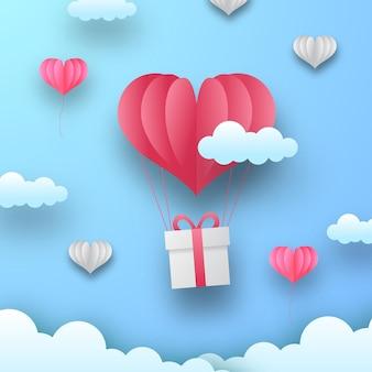 Баннер поздравительной открытки дня святого валентина с воздушным шаром формы сердца. бумага вырезать стиль векторные иллюстрации с синим фоном.