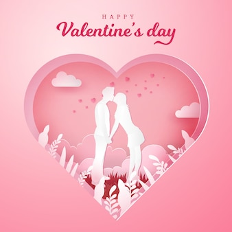 バレンタインのグリーティングカード。ロマンチックなカップルはキスをし、刻まれた心と手をつないで