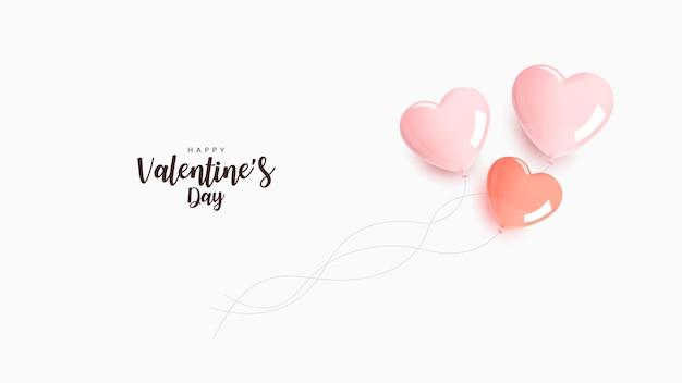 День святого валентина. гелиевые розовые и оранжевые шары в форме сердца на белом фоне.
