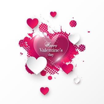 Праздник дня святого валентина с глянцевыми бумажными сердечками и акварельным всплеском.