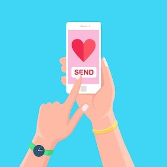 バレンタインデーのイラスト。携帯電話で愛のsms、手紙、メールを送受信します。背景に手に赤いハートのアイコンが付いた白い携帯電話。