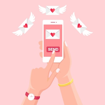 Valentine's day illustration. send or receive love sms, letter, email with white mobile phone. human hand hold cellphone, smartphone  on background. envelope with red heart.