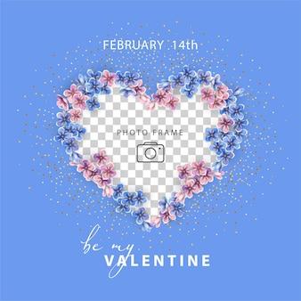 バレンタイン・デー。ピンクとブルーの小さな花で縁取られたハートの形をしたフォトフレーム