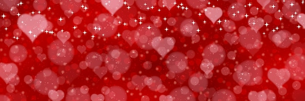 Valentine's day red blurred banner. red blurred background with hearts and light effects