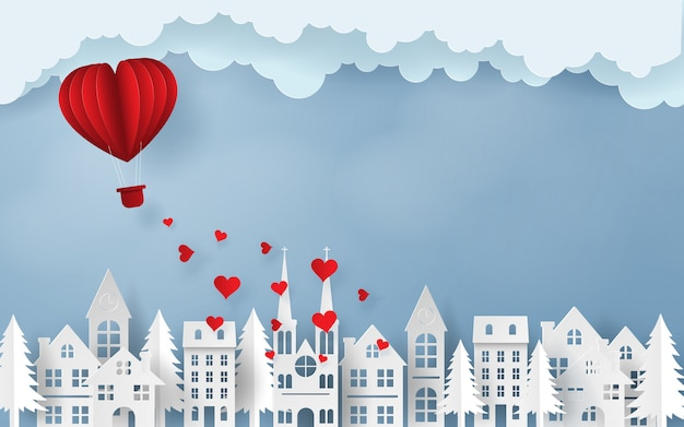 Valentine's day red heart balloon flying over the town