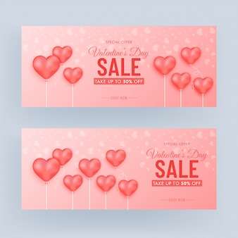 Valentine's day sale banner set with 50% discount offer and heart balloons decorated on glossy light red background.