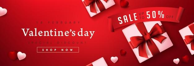 ギフトボックスとハートのバレンタインデーセールバナー。